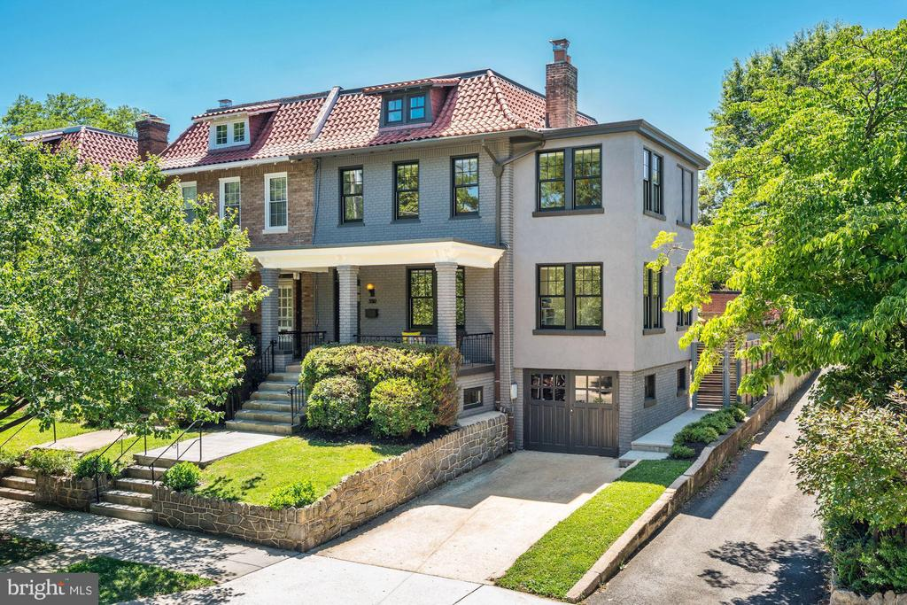This once traditional 1925 Cleveland Park home is the product of a fabulous 2016 modern renovation by Impact Construction, recently featured in DWELL Magazine! 5 BR, 3.5 BA, and approx 3,100 SF finished living space includes a quartz kitchen w/ top-of-the-line Sub-Zero, Thermador, and Bosch appliances, Fireplace, modern bathrooms, and fully finished industrial-style Lower Level with 1BR/1BA and second Kitchen, with access to rear garden. Private garden is fully fenced with professional landscaping, Ipe deck, patio, and custom concrete/Ipe bench surrounding firepit! Off-Street parking for 4 cars includes 1-car attached garage, 1+car detached garage, and 2-driveways! Amazing location just blocks between Cathedral Commons or Cleveland Park Metro!