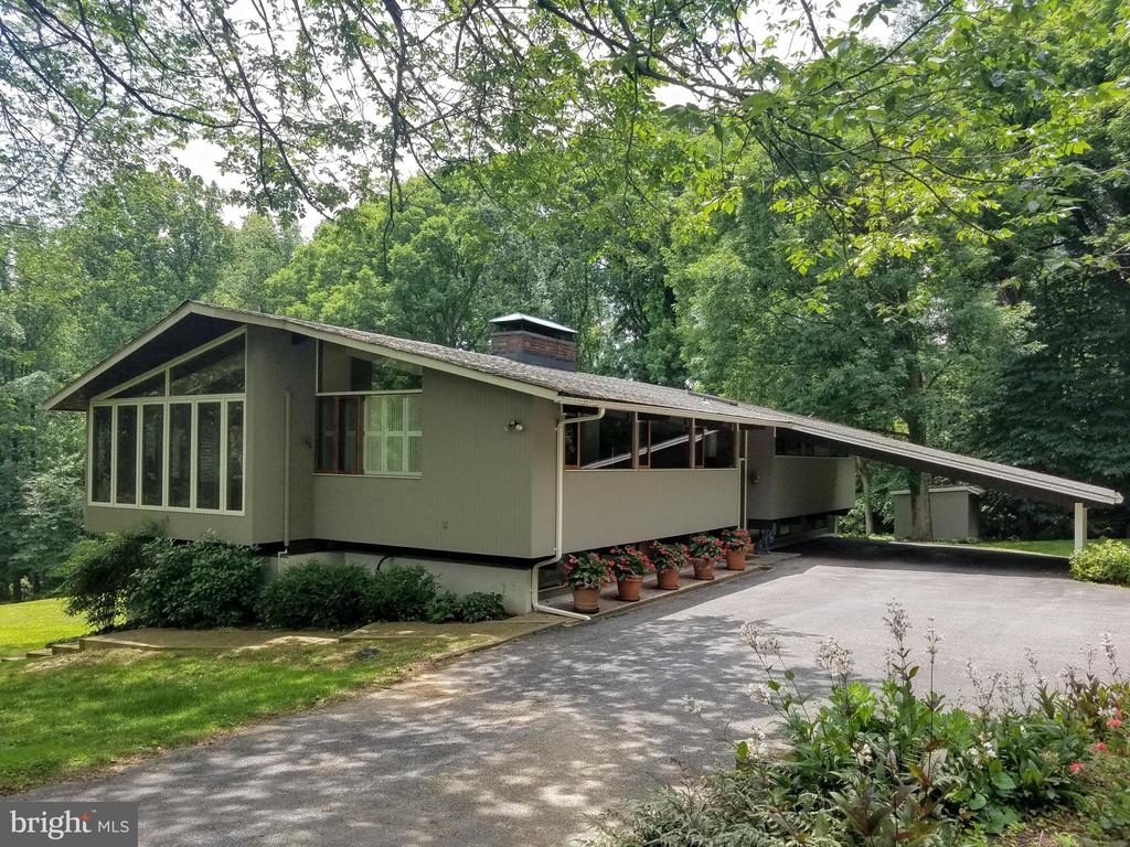 INCREDIBLE VALUE! TERRIFIC MID-CENTURY DECK HOME SITUATED ON A STUNNING 3+/- ACRE SITE. INCREDIBLE, ORIGINAL DESIGN COUPLED WITH THOUGHTFUL UPDATES-WOOD PLANKED AND BEAMED CEILINGS (VAULTED ON THE MAIN LEVEL)AND HARDWOOD FLOORING THROUGHOUT-LR WITH RAISED HEARTH FIREPLACE, BUILT-INS AND A WALL OF SLIDERS TO THE DECK THAT TAKES FULL ADVANTAGE OF THE VIEW-MODERN KITCHEN (2012) WITH KITCHEN AID STAINLESS STEEL APPLIANCES, GRANITE COUNTER TOPS, WALL OF GLASS FRONT CABINETS, EXPOSED BRICK WALL, AND OPEN TO THE DINING ROOM-DEN THAT FEELS LIKE A SUNROOM WITH HUGE WINDOWS-MASTER SUITE WITH THREE CUSTOM CLOSETS, SITTING ROOM AND FULL CERAMIC BATH- ADDITIONAL BEDROOM AND BATH ON THE MAIN LEVEL-DAYLIGHT LOWER LEVEL TAKES FULL ADVANTAGE OF THE VIEW AS WELL - FAMILY ROOM WITH RAISED HEARTH FIREPLACE, CUSTOM BUILT-INS AND SLIDER TO THE BRICK PATIO-BEDROOM #3 WITH A CUSTOM CLOSET- BEDROOM #4-BONUS ROOM CONVERTED TO A CUSTOM WALK-IN CLOSET-HUGE LAUNDRY/MECHANICAL/STORAGE ROOM THAT OPENS TO GRADE. TRUE IMPROVED LIVING SPACE IS OVER 3000 SF. PROPERTY ACTUALLY CONTAINS 2 SEPARATELY DEEDED LOTS - 1.62 ACRE (HOUSE LOT) AND 1.42 (ADDITIONAL LOT). SUCH A SPECIAL OPPORTUNITY - CONVENIENT TO EVERYTHING, BUT SO QUIET! ITS LIKE LIVING INSIDE A PERFECT VACATION RETREAT! BROKERS OPEN 4/10/19, 1-3:00