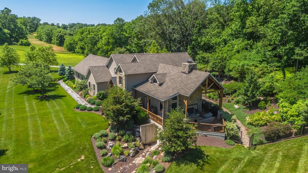 Incredible Custom Home on 37+ acres- boasts completely remodeled kitchen in 2018 with custom quartz counters with leathered granite, WOLF appliances, custom copper hood, custom wood beams, custom leather bench, opens to 2 story post and beam great room with floor to ceiling butler stone fireplace. Upper Level master with balcony, Loft, marble bath, fully finished lower level with wet and dry bars complete with river white granite and Italian porcelain, cork flooring framing marble, and 2 additional bedrooms. Expansive attached garage connects to mudroom complete with dog washing station, ceramic tile, granite counters, built in Pantry.  Outside features an over-sized deck with 2 story Butler Stone Fireplace, stone patio, and Peaceful Screened Porch overlooking landscaping and woods to wander.  Potential for 5 bedrooms.  Stream runs through woods of property.  Total Privacy in an ideal location, dog friendly with invisible fencing installed.