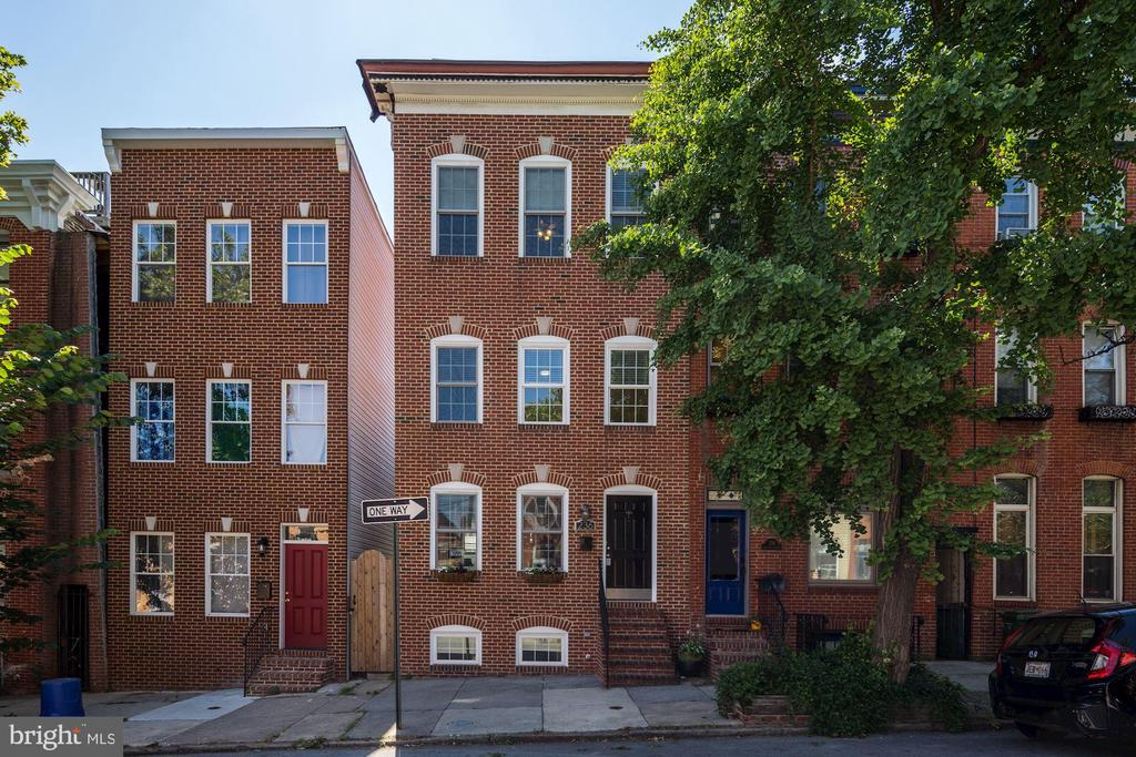 Price Decrease! Open House August 4th! Gorgeous 4 level Dream Home in Upper Fells Point/Butcher's Hill. Over 3000 SF of finished living space made up of airy and bright rooms much bigger than what you have seen.  There is nothing else like this in the city! 16 feet wide at the front, this 3+ bed/3.5 ba townhome on tree-lined street with front angle parking was re-built in 2005 and is beautifully updated. Brand new carpet throughout and freshly painted - shows like brand new. Huge finished basement with family room and built in English Pub. The bar, crafted by hand out of cherry to custom fit the rear pool table room, includes wine fridge and regular fridge, sink etc. (pool table conveys) No need to go out - they'll come to your house. All 3 giant bedrooms have a walk in closet and dedicated full bath with a super bath in Master and huge closet with built ins. Possible 4th bedroom in finished basement. Hardwood floors, stainless and granite in extra large, sunny kitchen with granite breakfast bar and eat in/morning room, separate formal dining room. Lovely back garden patio and panoramic city and water views from rooftop deck. Close to Fells Point, Canton and Johns Hopkins - great location! You have to see this house to believe it -this is a TON of house for the money.  You won't find anything larger and move in ready within Baltimore city for anywhere near this price. Do not miss this one!