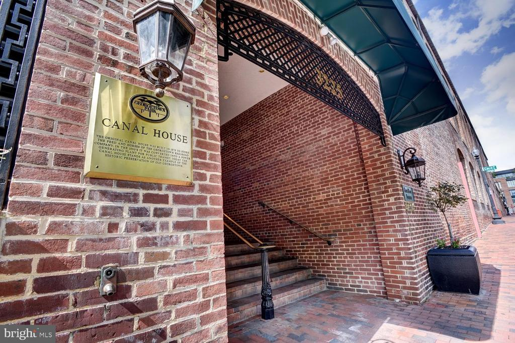 Spacious two level, two bedroom condo in the heart of Georgetown.  Nothing left for you to do except move in! Enjoy new flooring, renovated gourmet kitchen and the exposed brick wall in the dining area.  Both levels lead out to an expansive balcony overlooking the canal.  You'll have plenty of closet space with your walk-in closet and for added convenience, there is a washer and dryer in the unit.  You will also have access to the rooftop pool where you'll have spectacular views of the city. Or visit nearby M Street for shopping and the waterfront for fine dining.  Everything is at your doorstep. Extra storage and garage parking complete the package!
