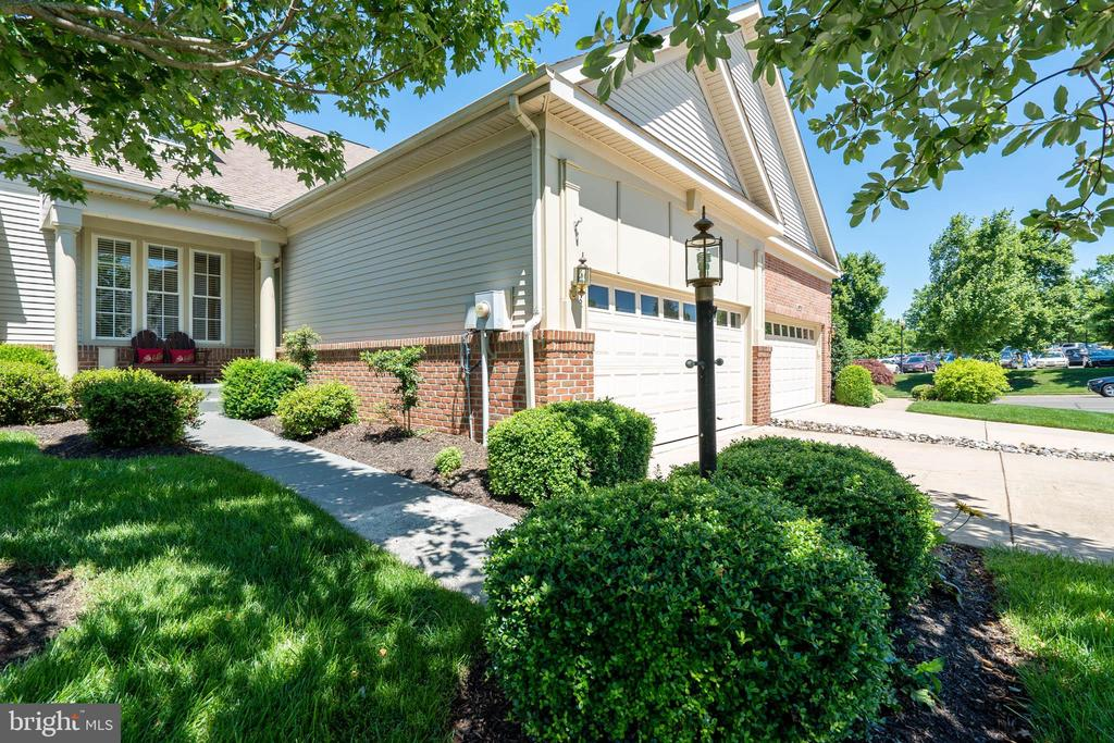 This three finished level attached Villa is located in 55+ Adult Community of Heritage Hunt**Enter from the front porch into a easy flowing main level**hardwoods in the living, dining, and Family room areas**main level den/office/study**Upgraded kitchen has newer cushioned vinyl flooring, gas cooking, newer dishwasher and refrigerator w ice maker**utility room off the kitchen leads to the 2 car garage**new washer and dryer**Utility sink and closet space**There is a cozy granite table for two or three in the kitchen**the family room is a nice size and has sliding door to a large deck**off the family room is a guest bath**the master bedroom has a walk-in closet and full shower bathroom**the upper level has 2 generous sized bedrooms and a large loft**the lower level consist of a huge recreation/game room (yes the pool table conveys--this table has built in a game table, and a ping pong table--all stored within the pool table)**there is a bonus/office**there is a half bath which has room for a shower or tub**off the bath is a storage room**off the recreation room is a storage room/work room**walk out from this finished lower level to a fenced back yard**Looking for a 2 or 3 generation living here it is!!