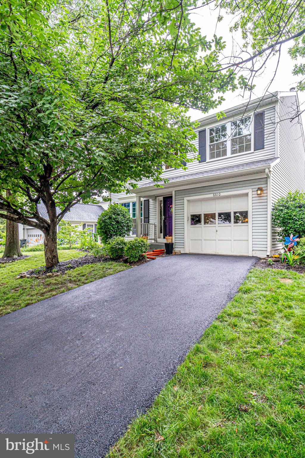 This is a must see! Beautiful Brazillian Cherry Floors throughout the living room dining and entry.  Recessed lighting added to the living room. Upgraded Bosch kitchen appliances, granite counters and recent recessed lighting in the beautiful kitchen. Separate breakfast room looking out over the back yard.  Family room with vaulted ceilings.  HVAC system replaced in 2013.  Roof and trim and downspouts 2016.  Master bath remodeled in 2017.   Main level half bath upgraded in 2016.  Driveway was just redone! Lovely deck with a pergola and beautiful gardens and a quaint yard.  All this in the wonderful Landsdown community with pool and so many features, plus so close to Wegmans and Ft. Belvoir.