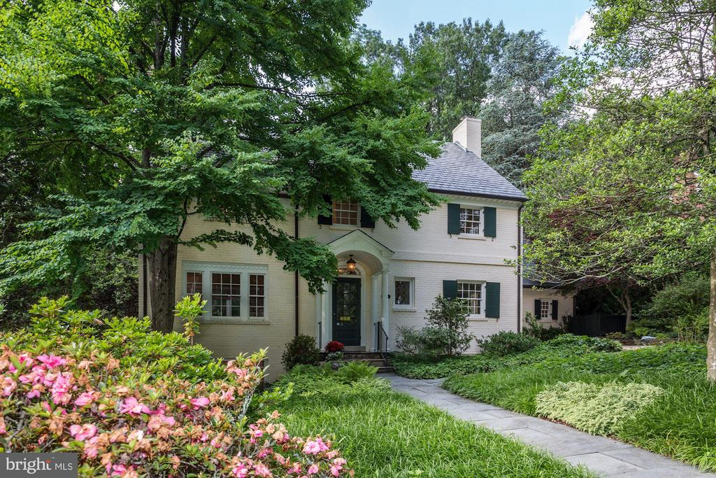 OPEN SUNDAY 2PM - 4PM. This appealing brick colonial, with two Master Bedrooms, framed by vintage trees, is located half a block from the popular nature trails, sledding hill and canine rendez-vous of historic Battery Kemble Park. The first floor includes traditional living and dining rooms, stunning garden room/ family room, and master suite which opens to a charming, terraced garden. Above, four bedrooms and three bathrooms. Finished lower level.