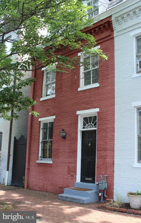 Truly a must see! Light and bright historic 2/3 bedroom townhouse only 4 blocks from King St metro. Large windows, high ceilings, formal living room, separate dining room, both with fireplaces (decorative only), brick floor in large eat in kitchen, walk out to private brick patio, carport provides 1 off street parking spot. High ceilings, period details. New tile and bathtubs in both full baths.  Pets on case by case with deposit. *Note, third bedroom on third floor is accessed by walking through second bedroom. Second bedroom perfect for nursery, office or tv room. Huge storage on upper level.  So much bigger than it looks.