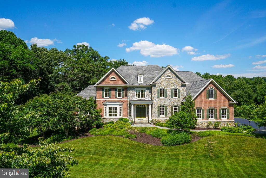 This magnificent 8,000 square foot colonial is located in one of McLean~s most prestigious neighborhoods. Designed with distinction, this stately colonial, with open floor plan, is ideal for everyday living as well as more formal entertaining.  This exceptional home features 5 bedrooms, 5 full and 2 half baths with meticulous detailing and high-end finishes throughout. This home is ideal for grand-scale entertaining with great flow through the over-sized family room that features floor-to-ceiling windows, leading into the gourmet kitchen and elegant dining room  which is attached via a butler~s pantry. The expansive kitchen is well-appointed with beautiful cabinetry, top-of-the-line stainless steel appliances, double dishwasher, a center island, granite countertops, and a light-filled breakfast room leading back to the two-story family room. The sun-filled main level also hosts an exquisite conservatory/music room, an office, and a formal living room.  The elegant front and back stairways lead to the upper level that hosts a spacious and luxurious master suite that is complete with oversized closets, elegant tray ceilings, a fireplace, and a separate sitting room.  The master bath features a soaking tub, large shower, and separate water closet. In addition to the spectacular master suite are three additional bedrooms, each with its own full bathroom and roomy closets.  The bright walkout lower level is also perfect for entertaining with its spacious recreation room, game area, exercise room (or theatre room). The lower level also boasts a full wet bar with granite counter tops, a refrigerator, sink and dishwasher - ideal for the guest or au pair suite. A bonus room and fifth bedroom complete this oversized lower level. This exceptional home sits on a premium 1.86 acres lot and boasts a 3-car garage. ~Located near downtown McLean, this home is only minutes to Tysons, local parks,~ and various shopping and dining options with easy commuter access to Tysons, 66 and 495