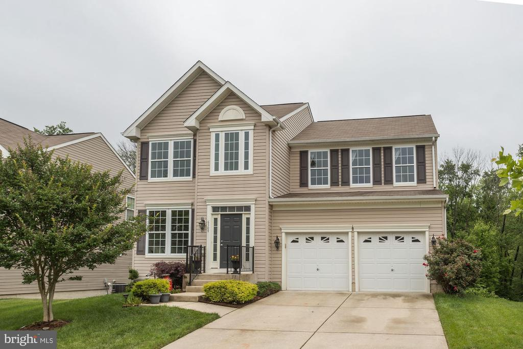 This Beautiful Colonial Shows Like A Model and Features 2 Story Hardwood Foyer*Custom Kitchen with 9 Foot Ceilings,42' Oak Cabinets,New Granite Counter Tops and Island, Breakfast Nook with Slider to Rear Yard*First Floor Family Room with Gas Fireplace*Second Floor with Huge Master Bedroom with Cathedral Ceilings, Super Bath with Double Sink and Walk in Closet*Freshly Custom Painted Throughout* Finished Walkout Basement with 5th Bedroom and Rough-in Bath* 20x12 Rear Patio that Backs the Woods. This is a must see, Bring Your Family and See For Yourself. For Showings Call CSS
