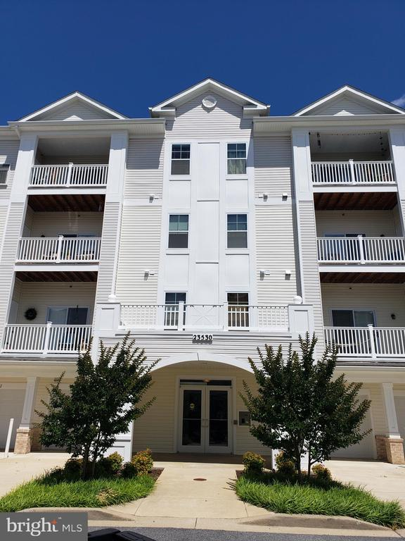 PRICE REDUCED!!! LIKE NEW! Maintenance-free living. Secure UPSCALE building, w/ Elevator, Condo w/ Climate Controlled 1 Car Garage. Gorgeous Kitchen with Granite Countertops, SS Appliances.  Walk to Restaurants, Shops & Harris Teeter! Minutes from Pax River.  Come take a look - you'll fall in LOVE!