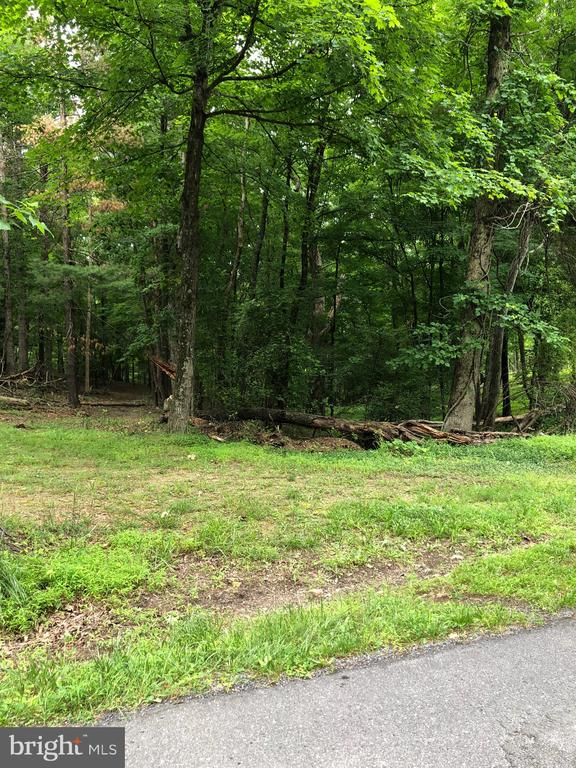 12 Wooded Unrestricted Acres -  located along a county maintained road on the Southern end of Morgan County. Hunt, Camp, Ride ATV, build your dream home.