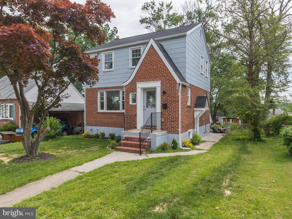 JUST REDUCED! Fantastic rehab!  You'll be blown away by this amazing detailed renovation of this 1954 brick Art Deco-inspired classic. Rarely-found open floor plan on main level with recessed illumination gives way to a stunning kitchen with waterfall island, under-mount sink and quartz countertops with pendant lighting. Stainless steel appliances compliment the tiled backsplash. Handsomely subway-tiled bathroom with free-floating glass frames. Fully built-out basement can be rented and has a separate entrance. Huge backyard and deck too. This is a must-see!  Won't last long!