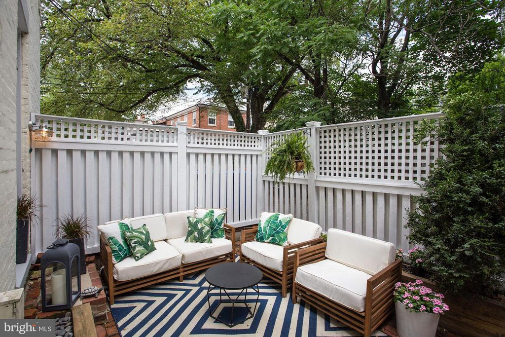 REDUCED! OPEN SATURDAY 1-3 AND SUNDAY 2-4! Private parking + Private terrace + Prime Location = Perfection! Welcome to this wonderful, sun-drenched home in one of Georgetown~s most sought-after locations. Fully updated, this home boasts an assigned parking spot and one of the best terraces in Georgetown: sunny and private with dreamy, open-sky views! Among the many features of this fine home are the open floor-plan, original hardwood floors, sunny kitchen, updated bathroom, in-unit washer & dryer, and a low monthly fee! This home is completely turnkey; you can move right in. Located just steps to fine restaurants and shops, and nestled among multi-million dollar mansions, this ideally-situated home is a peaceful oasis in one of the country's most bustling, historic neighborhoods. A private storage shed and assigned parking spot convey. Pets are welcome. Low fee! Cap rate of nearly 5%! Investors - hurry!