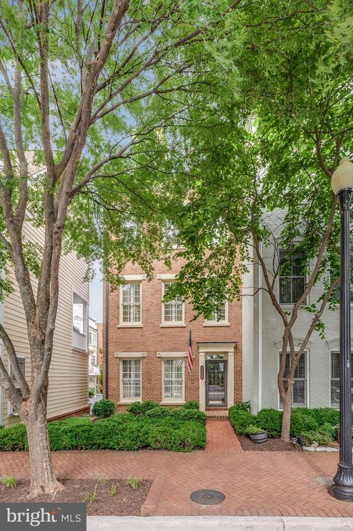 Make this corner townhome nestled in the heart of Potomac Greens that is set back off its own private lawn your home.  Enjoy the library off the foyer or sit by your warm fireplace on the main level or end the evening on your rooftop terrace.  There is plenty to love about this wonderful property. Partake in the array of amenities this community has from clubhouse, exercise room, outdoor heated pool and nature trails.  Only minutes from the heart of Old Town Alexandria and its vibrant waterfront with community shuttle service to the Braddock Road Metro Station; adjacent to the George Washington Parkway and the Mount Vernon bicycle trail; only two traffic lights to our Nation~s Capital and Reagan National Airport.
