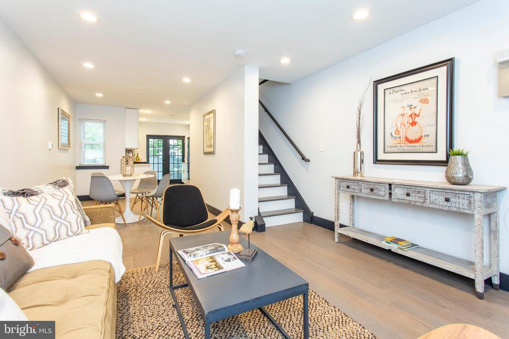 Wow, renovated top to bottom, inside and out, this Point Breeze home is practically new construction! Boasting 2100 + square feet of living space! Wide open main floor plan flows from living to dining to kitchen area, with french doors leading to the large backyard flooding the whole space with natural light. Beautiful kitchen with all new stainless appliances. Fully finished basement with powder room. Upstairs find 2 nicely size bedrooms, a sleek, large full bathroom, and laundry. Continue to the third floor to find the master retreat -- Spacious bathroom with extra large shower and double vanity, huge walk in closet and just a flight of stairs away from the roof deck with amazing city views.