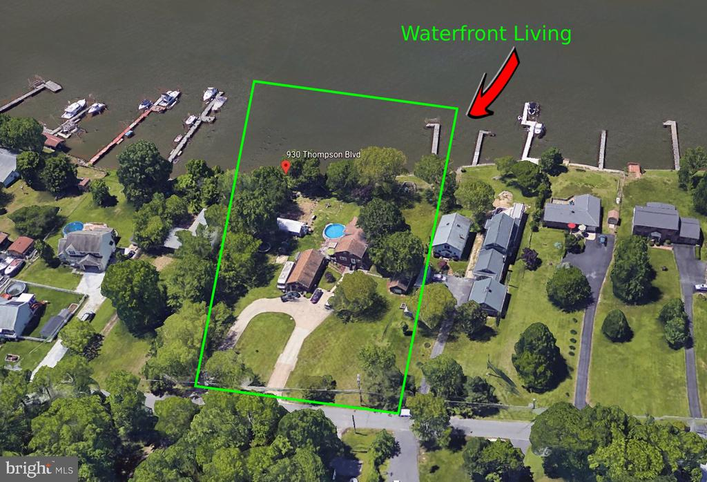 OPPORTUNITY KNOCKS HERE ON THIS FABULOUS 1.72 ACRE HOME SITE THAT IS UP HIGH AND DRY WITH NO FLOOD INSURANCE REQUIRED AND OVER LOOKING THE SCENIC BACK RIVER. THE LAND ALONE OFFERS OVER 200'FT OF FRONTAGE WITH AN EXISTING 150'FT PIER, PLATFORM AND MOORING POLES!! EXISTING ON THE SITE IS A LARGE 3 STORY BRICK CAPE COD HOME IN-WHICH COULD BE RENOVATED AND OR RAZED. ALSO ON THE SITE IS AN EXISTING CLUB HOUSE WITH A COMBINATION INDOOR AND OUTDOOR FIREPLACE AS WELL (2) SEPARATE BRICK DETACHED GARAGES. ONE GARAGE OFFERS 2 CAR STORAGE AND ONE OFFERS SINGLE CAR STORAGE. NUMEROUS POSSIBILITIES EXIST HERE FOR YOU.  AGAIN RENOVATE THE EXISTING STRUCTURES OR BUILD MULTIPLE WATERFRONT HOMES AND OR EVEN JUST ONE MEGA HOME. THERE ARE ALREADY MANY NEWER CONSTRUCTION HOMES IN PLACE UP AND DOWN THE VERY MATURE AND SCENIC THOMPSON BLVD. THE AREA IS SURROUNDED BY WATER, WOODS AND NATURE. ALSO JUST A FEW STEPS FROM THE PROPERTY IS ACCESS TO PUBLIC FIELDS AND PARKS.