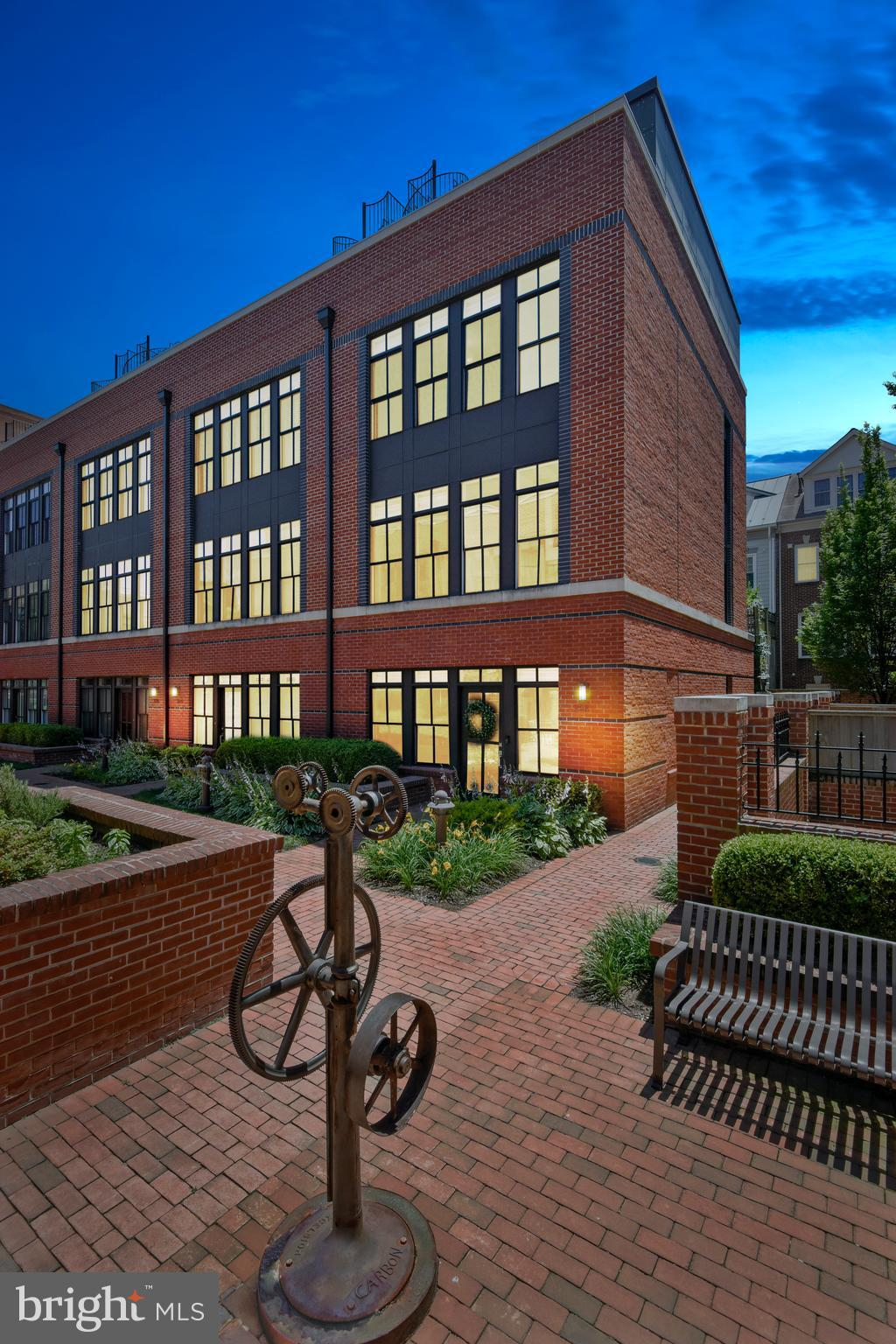 Beautiful luxury end unit townhome in Printers Row!  This private gated enclave of North Old Town is situated steps away from the Mount Vernon Trail, riverfront parks and the George Washington Memorial Parkway for easy access to DC.  Walking distance to everything King Street has to offer: restaurants, bars, shops, art galleries and more.  With the arrival of Amazon HQ2, the Virginia Tech Campus and plans for the new Arts Corridor in North Old Town, this is an amazing opportunity to get in early!  This home has so much to offer for contemporary Old Town living: huge windows throughout provide wonderful natural light to this bright, open space.  328 Third Street boasts many upgrades and custom features not available in other units, including a walk-in first floor pantry and coat closet, a walk-in 4th floor storage closet and a 4th floor wet bar.  Other upgrades and features include new quartz kitchen counter-tops and island, white subway tile back-splash, custom closets and built-in chest of drawers in the master bedroom, and custom closets in 2 additional bedrooms on the 3rd level and laundry space.  Fantastic open floor plan on the main level with Wolf gas range, Zephyr hood range and Kitchen Aid refrigerator and dishwasher.  Upgraded light fixtures throughout.  All levels have been freshly painted and a new furnace installed in 2018.  The entire 2nd level is dedicated to a fabulous Master Suite including a large master bath with double vanity, shower and Victoria & Albert bathtub.  4 separate outdoor spaces are perfect for relaxing and entertaining, including a main level patio, master bedroom balcony, 4th level terrace and rare rooftop sun deck with unparalleled views of the Potomac River and DC!  A rare Old Town gem!
