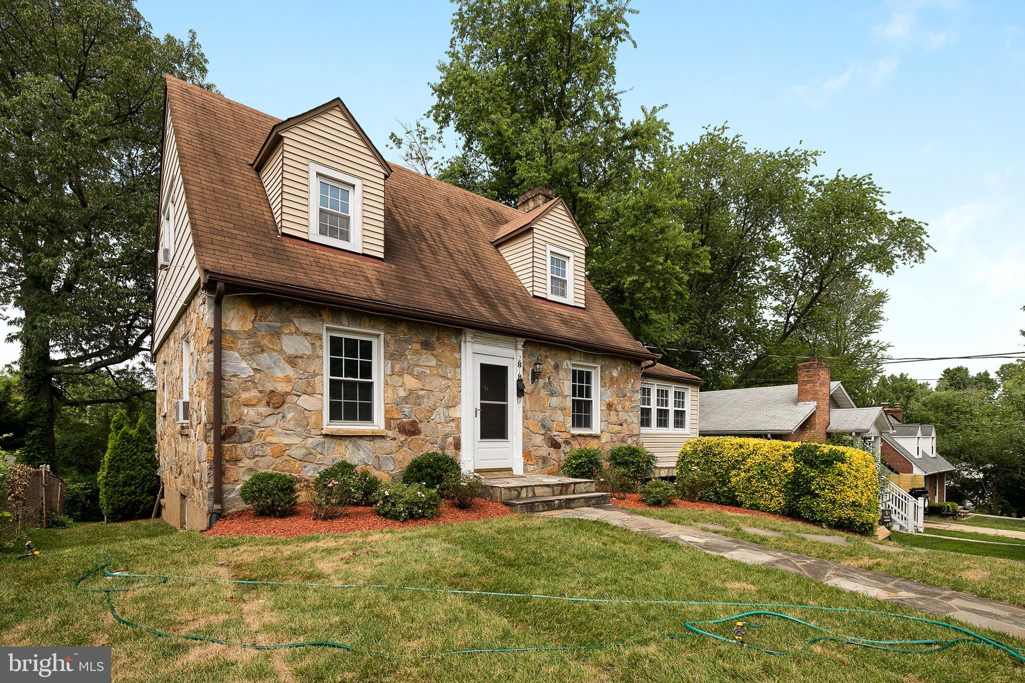 Enchanting stone Cape Cod in the quiet and friendly Greenway Downs neighborhood of Falls Church.  Original hardwood floors on the main level. Living room features a wood burning fireplace with stone mantel. Finished lower level has a kitchenette and can serve as a rec room or in law suite.  Bonus room added over garage.  One car garage and driveway for off street parking.  Conveniently close to Dining and shopping. Just minutes to beltway via 29 or 50.