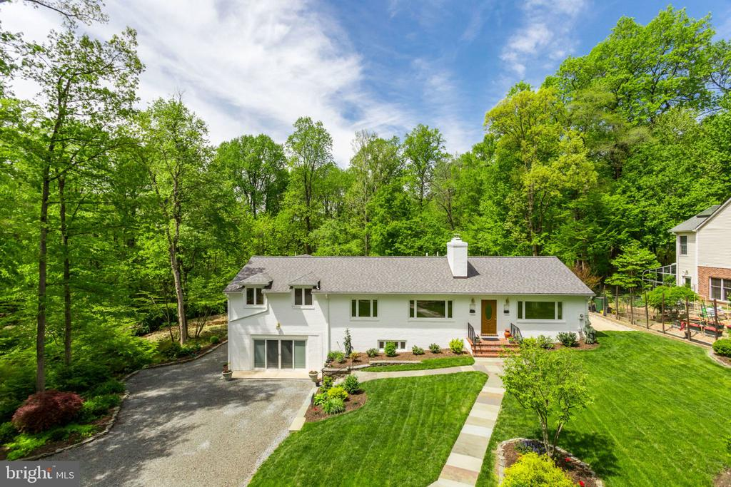 "**OPEN SUNDAY, 6/30, 1PM-4PM** One-of-a-kind rambler on impeccably landscaped lot backing to peaceful stream and 20+ acres of parkland and Green Spring Gardens!  This home displays pride in ownership at the highest level - expanded and rebuilt in 2004 with new framing, electrical, plumbing, mechanical systems, and much more!  5 bedrooms, 3.5 baths and nearly 4,800 sq ft of finished space. Bright and open floorplan with chef's kitchen, including oversized island, top of the line appliances (48"" Wolf range + vent hood, 48"" GE Monogram refrigerator), and 4 skylights to bring in lots of natural light.  New hardwoods throughout the main/upper levels and new carpet on the walkout lower level.  All completely new bathrooms as part of the 2004 rebuild/expansion (plumbing, tile, fixtures, location, etc.).  Luxurious master suite with large walk-in closet and French doors that overlook the serine backyard and stream. The attached master bath includes beautiful tile work, separate jetted tub, oversized shower, and large vanity.  The light filled lower level includes a huge rec room with gas fireplace, 2 spacious bedrooms, full bath, built-in cabinetry w/granite bar, tons of storage, and walkout to concrete patio.  New roof in 2013 with architectural shingles, R-30 attic insulation, newly lined wood-burning fireplace, and whole house vacuum system.  New custom shed with matching roof in 2017.  Original planned 2 car garage was converted to ""finished storage space"". Meticulously maintained landscaping throughout entire property ~ pots do not convey.  Escape from the daily hustle and relax in this paradise of a setting just minutes from 395, Crystal City, and Washington DC!"
