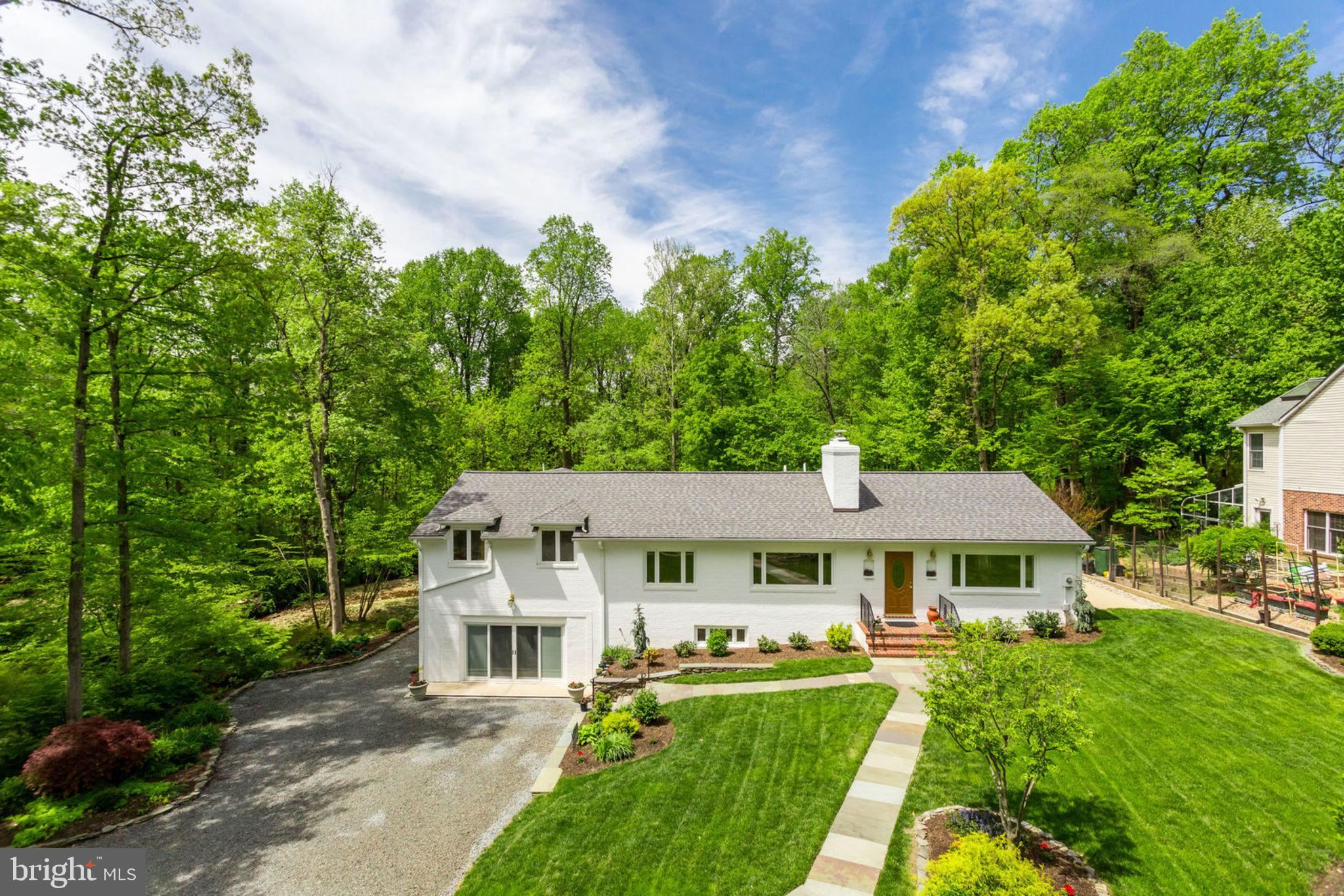 """**OPEN SUNDAY 1PM-4PM** One-of-a-kind rambler on impeccably landscaped lot backing to peaceful stream and 20+ acres of parkland and Green Spring Gardens!  This home displays pride in ownership at the highest level - expanded and rebuilt in 2004 with new framing, electrical, plumbing, mechanical systems, and much more!  5 bedrooms, 3.5 baths and nearly 4,800 sq ft of finished space. Bright and open floorplan with chef's kitchen, including oversized island, top of the line appliances (48"""" Wolf range + vent hood, 48"""" GE Monogram refrigerator), and 4 skylights to bring in lots of natural light.  New hardwoods throughout the main/upper levels and new carpet on the walkout lower level.  All completely new bathrooms as part of the 2004 rebuild/expansion (plumbing, tile, fixtures, location, etc.).  Luxurious master suite with large walk-in closet and French doors that overlook the serine backyard and stream. The attached master bath includes beautiful tile work, separate jetted tub, oversized shower, and large vanity.  The light filled lower level includes a huge rec room with gas fireplace, 2 spacious bedrooms, full bath, built-in cabinetry w/granite bar, tons of storage, and walkout to concrete patio.  New roof in 2013 with architectural shingles, R-30 attic insulation, newly lined wood-burning fireplace, and whole house vacuum system.  New custom shed with matching roof in 2017.  Original planned 2 car garage was converted to """"finished storage space"""". Meticulously maintained landscaping throughout entire property ~ pots do not convey.  Escape from the daily hustle and relax in this paradise of a setting just minutes from 395, Crystal City, and Washington DC!"""