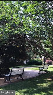Location! Just minutes from DC, near bike path, Spacious quiet end unit townhouse on interior of manicured courtyard in Old Town, Alexandria, 3BR, 2 1/2 baths, underground parking space, galley kitchen, marble countertops, hardwoods throughout.  DR w/step down to spacious LR w/FP. Elegant Master Suite!