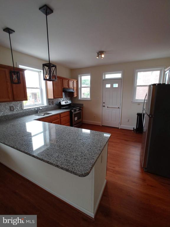 Come and check out this newly renovated 3 bedroom 1.5 Bath end of group that features new wood laminate flooring , Granite counter tops and stainless steel appliances. Also has new carpeting , fixtures , ceiling fans and basement has been renovated with laminate flooring new paint and vanity ;possible study/ Den ...make your appointment today!
