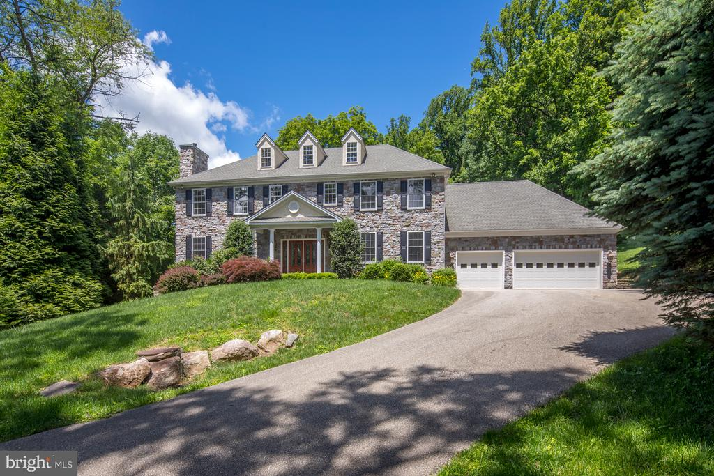 An impressive residence with extensive upgrades, this custom-built stone manor home in coveted Bryn Mawr is just what your family~s been looking for, in the location you~ve always dreamed of! Nestled on 1.3 private lush acres, boasting 6,200 sq ft of impeccably-designed, thoughtfully-planned living space, this grand 3-story beauty with 6 bedrooms and 6.2 baths is the finest combination of classic and modern. Among the many improvements of this rare offering is a fully freshly-painted interior, new top-of-the-line kitchen appliances, new hardwood flooring on the 2nd floor, new carpeting on the lower level, the list goes on. Once you~ve caught your breath from the stunning exterior, an elegant double-height foyer with a flared staircase, gleaming hardwood floors and soothing color tones begins the sophisticated experience inside. Flanking the foyer is a living room with gas fireplace, and wainscoted dining room that connects to a butler~s pantry/wet bar & gourmet kitchen ~ a floorplan built for entertaining. A spacious, sunny kitchen is fit for the chef and the ultimate gathering spot for family, featuring premium cabinetry & appliances, granite countertops & backsplash, an open breakfast area & sliding glass doors to the rear deck where you can lounge or barbecue with a backdrop of nature views. The adjacent sky-lit family room, centered by a wood-burning fireplace, makes this the heart of the home. Through double French doors sits a quiet office with gas fireplace and built-ins. Completing the main level is a laundry room, half bath, and attached 3-car garage set conveniently off the kitchen. Unwind in comfort upstairs in your master suite with a vaulted ceiling, 3-sided fireplace, sitting area, custom-fitted walk-in closets & a luxurious private bath. Three additional bedrooms and full baths provide ample accommodations for family and visitors. The finished walk-out lower level extends the living space with a 2nd family room with fireplace, home theater with huge s