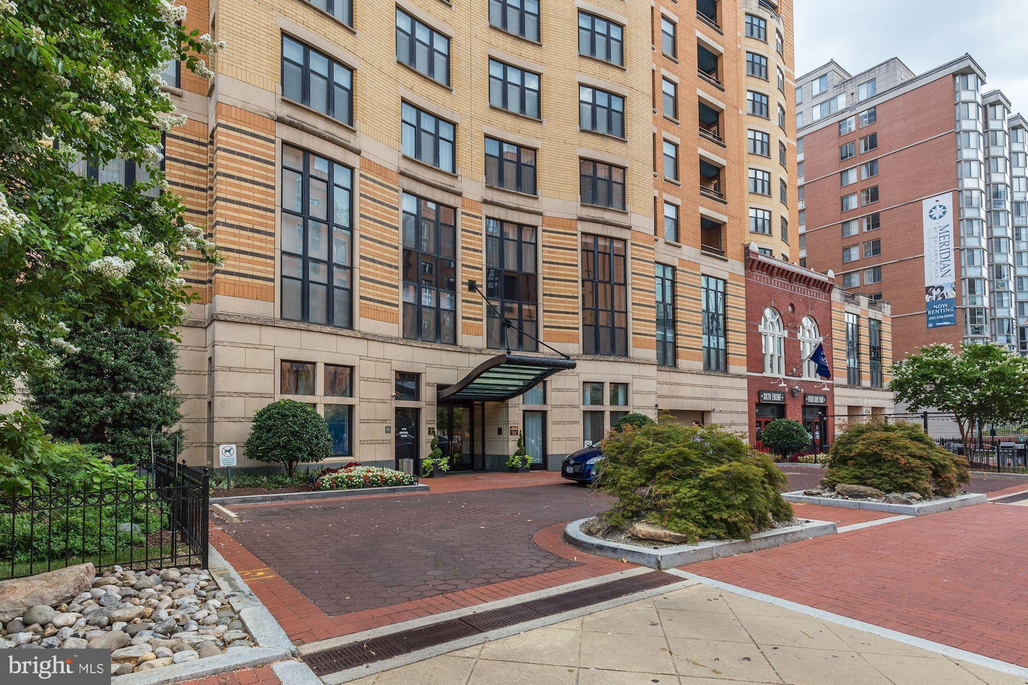"""Featured in the upcoming Washington Post """"Town Square"""" as one of D.C.'s most affordable of the week for first-time homebuyers! Check it out! Great downtown location.  Fantastic 8th floor turn-key condo in one of Mt. Vernon Triangle~s most popular addresses. This home has all the bells and whistles you~d expect and then some~.hardwood floors, granite counters, stainless appliances,Newer washer and dryer. Meticulously designed and improved for ease and comfort including sound proofing panels, black out blinds for lazy Saturdays and hand-crafted built in shelving for dining, working and entertaining.  Recently renovated mid-century modern inspired bathroom with wood paneling and subway tile. 400 Mass Ave is a FULL service building. 24 hour concierge to accept packages and provide helpful assistance. AMAZING rooftop with swimming pool, grills and 360* views of DC including a stunning view of the Washington Monument and U.S. Capitol. This is """"the place to be"""".  Reserve one of many different areas for your next get-together with friends. A newly renovated party room (2nd floor). Business center for quiet work space. Large on-site gym (3rd floor). Garage parking available and pet friendly! Basic Verizon Fios wifi is included in condo fee. Super accessible~just 3 blocks to Red, Blue, Yellow and Green Metro Stations and easy access to I-395.. 94 Walk Score, 100 Transit Score, 95 Bike Score. Anything and everything can convey!! Your choice!"""