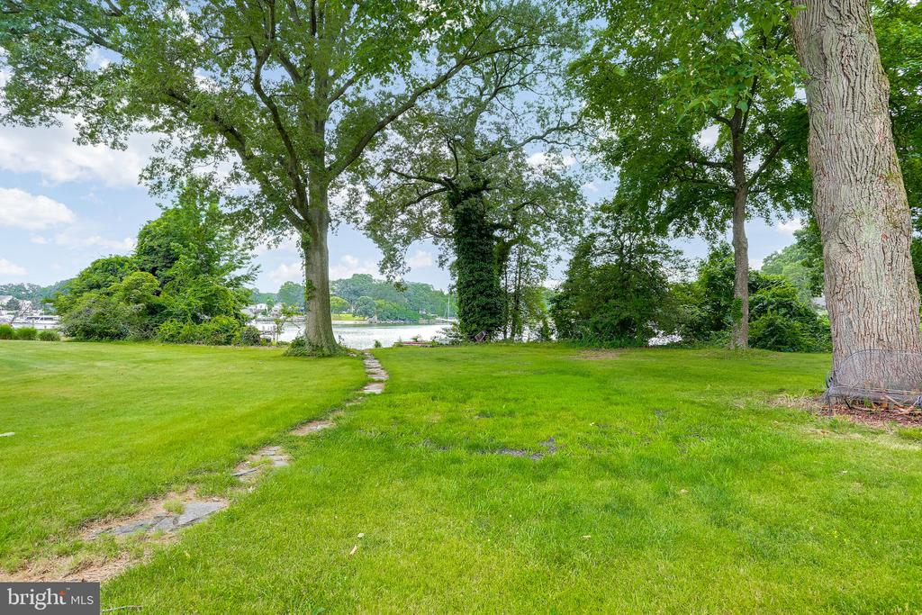 COMING SOON: AS-IS Property,   value is in the land, over 4 acres of waterfront with boathouse