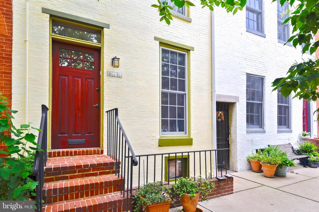 Unique multi-family listing on the premier block of William street, one block from the Inner Harbor and Federal Hill Park: The front three story home has recently been professionally redesigned. The main home includes: 1st floor-living room centered around the fireplace. The kitchen has soapstone countertops, custom cherry cabinetry, pantry, closet and cork flooring with high end European restaurant grade appliances (incl. gas range). 2nd floor - large master bedroom includes: fireplace, full bathroom, with a closeted laundry room.3rd floor - full bathroom and large master bedroom or office space. The rear attached carriage house is ideal for a mother-in-law or nanny suite, possible rental income or a potential of both units to be integrated as one home. The 1st floor has a kitchen, dining area, living room and powder room. Kitchen looks out on the back courtyard. On the 2nd floor, full bath with closeted laundry room, one large bedroom overlooks the patio garden. Both residences are secure with a gated and locked entryway leading to an expansive and private courtyard with a mature garden, backyard dining area and a Hot Springs hot tub.