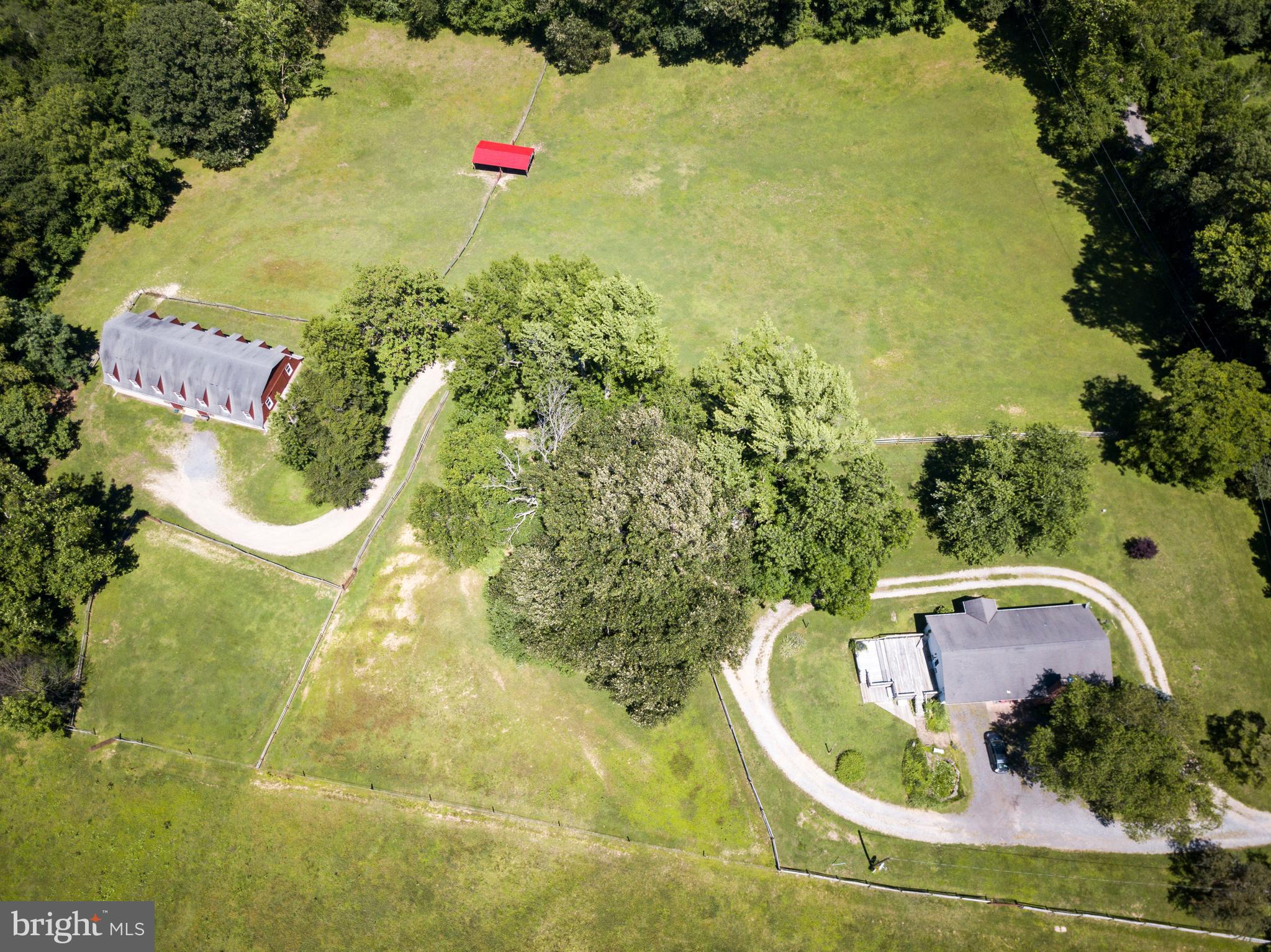 Horse lovers look no further!! Over 12 acres of rolling fields surrounded by mature trees and fencing.  The spacious 2 story horse barn was architecturally designed by DuPont.  This custom barn offers ten 12x12 adjustable stalls.  Stalls can be made 24x24 or 36x36 for birthing or breeding.  Tongue and groove (no nails anywhere) solid oak board stalls, a feed room, tack room, wash area with drainage, drive up hay bale opening, as well as 5 storage units with electric in the loft just to name the basics.  The barn also offers custom drainage features, reinforced cable for structural integrity and is a well cared for space for the horses and horse owners!  The property offers six fenced in pasture areas, a run-in shed and a stud barn.  Thank advantage of your own private riding trails, rolling hills for plenty of exercise, a stream and a potential for a riding ring.  A loving cared for ranch home sits at the top of the hill overlooking the beautiful 12+ acres.  The house offers hardwood floors, fireplace, french doors, a possible small 3rd  bedroom or office (currently a laundry room)on the upper level and 2 car garage.  The lower level of the house has a separate in-law apartment or au-pair suite with kitchen, granite counter tops, separate bathroom and separate entrance,  The seller currently participates with an optional land preservation trust program through AA county resulting in reduced real estate taxes that are currently less than $1,000/year.  That saves thousands of dollars per year!  Other possible uses for this property are as a winery or wedding venue.  We can provide list of features of the property. 24 hour showing notice.  This is located at the end of the road and is not an easy drive by property.