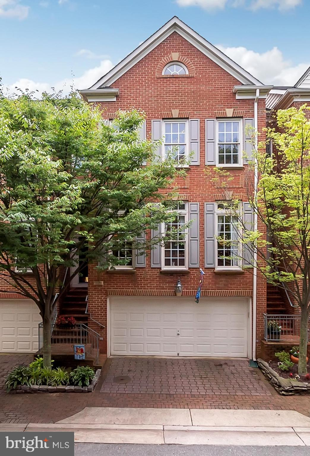 Please enjoy this 3 bedroom, 3 1/2 bathroom, 2594 sq.ft. townhouse in the sought-after Cameron Station, which is the premiere community in Alexandria's West End. This house is a rarely available 3-level NV Franklin model with upgrades throughout the house. This house offers its new owner mature tree privacy to enjoy your deck and patio, which is a highly desired feature within the community. The house opens to an entry where a designer-chosen pendant chandelier in an eye-pleasing Winter Gold finish is the welcoming design feature. The entry leads to an open Living Room and Dining Room, with a 9-foot ceiling, compound crown molding, and another designer light fixture in the Dining Room that provides visual appeal throughout the Main Level. The Dining Room leads to the open kitchen, which has an island for both food preparation and easy conversation, space for informal dining in front of a bank of three windows, and a large space for entertaining or relaxation. The kitchen offers the cook high-end granite (newly installed), a tile backsplash, hard-wired undercabinet lights and cove lighting, black appliances, and mahogany finish cabinets. The open kitchen space leads to a deck which offers mature tree privacy, which is enhanced by the retractable awning. While the view looking out from the deck is a green-screen view, the view looking down at the enclosed patio area delights the eye with the professional landscape design choices, with a green lace-leaf Japanese maple the main focal point. The half bath is on the Main Level, with a Kohler pedestal sink, upgraded Moen fixtures and accessories, framed mirror, and light fixture. The Master Bedroom is sized to fit a King-size bed with a tray ceiling, three windows to allow in natural light, and a large walk-in closet. The Master Bathroom has dual vanities, a separate tub and shower, and a Water Closet for privacy. The entire bedroom level has hardwood floors. The two spare bedrooms are each sized for a Queen bed with a dou