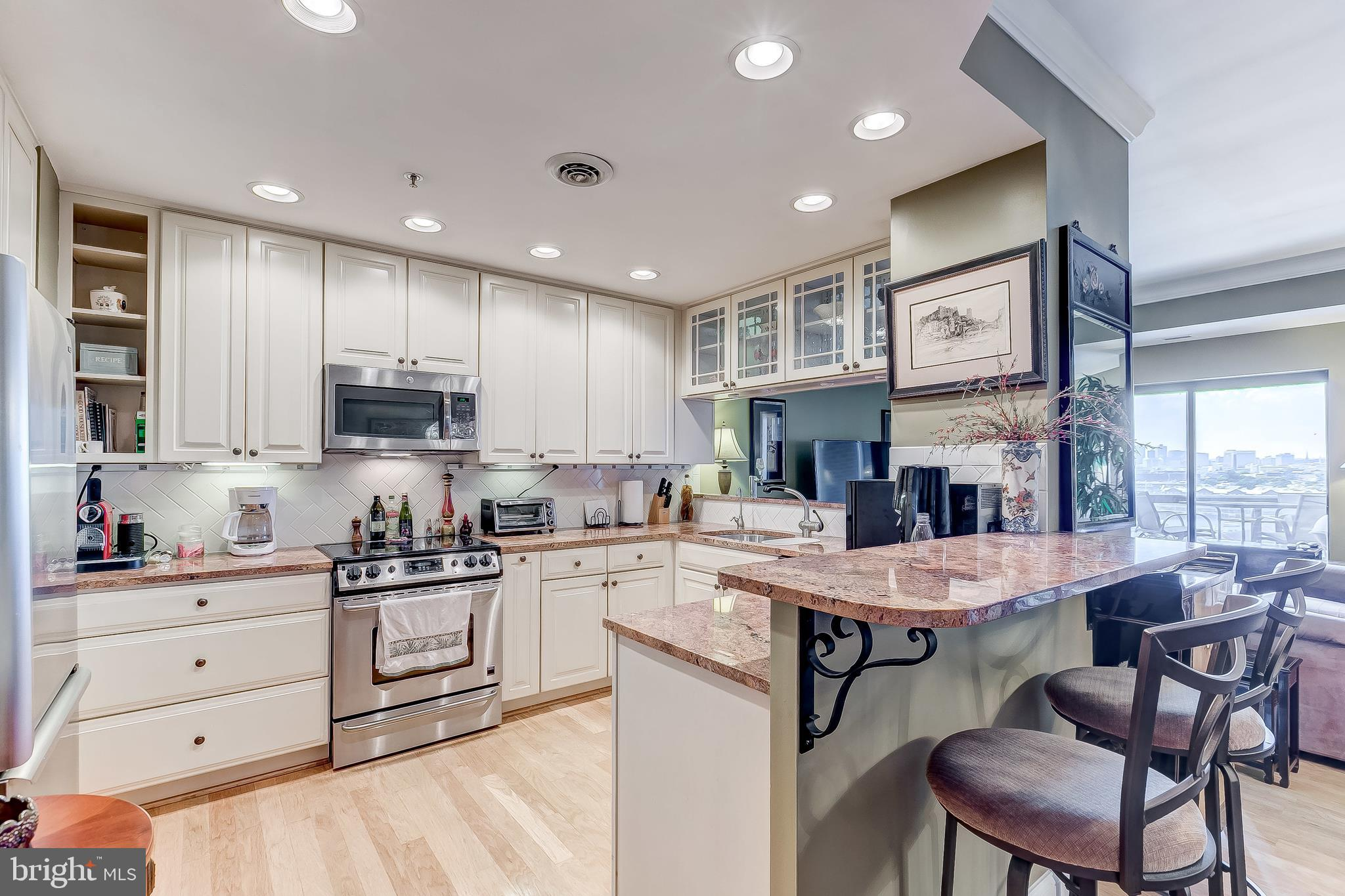 SELLING AGENT BONUS OF $2000 ON THIS UNIT. Great 2 bedroom, 2 full bath located in the Anchorage Towers.  Updated throughout, crown molding, marble, wood floors and great view of the downtown city skyline and water.  Private balcony and 2 parking places