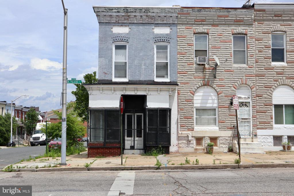 INVEST / BUSINESS OWNER alert. End unit Baltimore rowhome in need of TLC. Property is in completely move in condition and needs some elbow work to call it home for another homeowner, business owner, or investor looking for a turn key rental. Main level was a hair salon with upper level as a separate apartment. Property being sold as is.