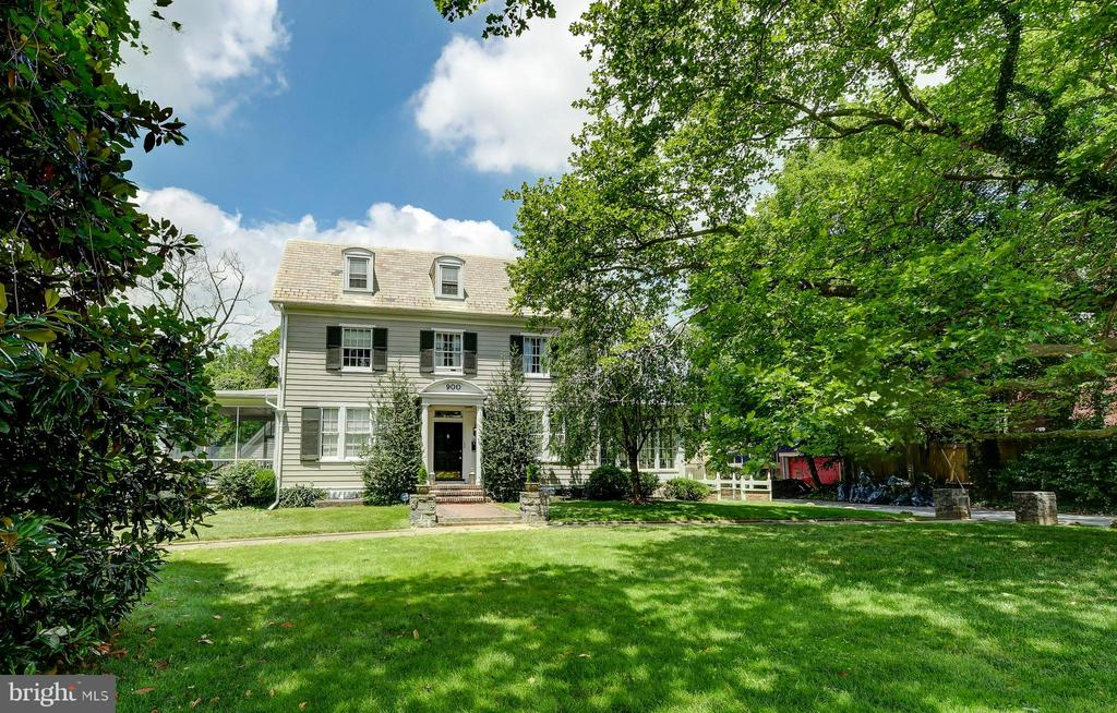 MAJOR PRICE REDUCTION.  $9,000 credit to refinish hardwood floors.  Gracious home with access via Roland Avenue to lightly traveled Gascony Lane.   Walk to Roland Park area schools - private and public in 3 minutes - truly.   Spacious fenced rear lot for kids and pets to romp.  Stunning all white and stainless gourmet cook's kitchen, a 2015 redo, includes marble countertops and island, custom cabinetry and built ins, Miele refridgerator/freezer, Wolf range, wine chiller and more.  Rooms galore to live, play and study. Screened porch on west side, and four season sun room on  east side.  Original details are everywhere, including inlaid floors and paneled, beamed dining room.  Convenient to local shopping and major byways.