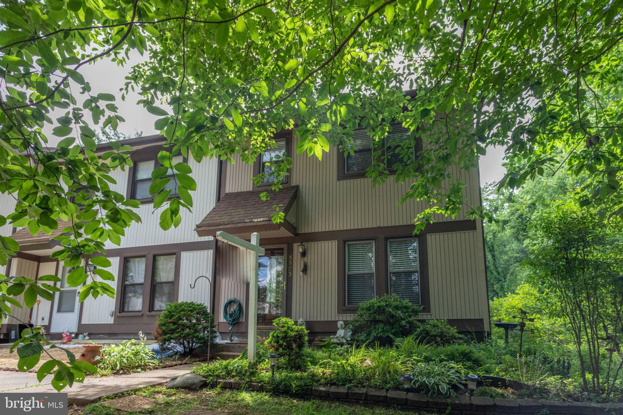 Lovely, 3 bed, 2 full and 1 half bath end unit townhome in the coveted Greenfield Farm community.Largest composite deck in neighborhood installed in 2015 backs to woods & open space and amazing privacy and personal oasis.Tons of upgrades in 2018 including a new roof, upstairs  HDWD floors, Dishwasher, Refrigerator and Stove, Washer/Dryer, and upstairs bathrooms renovated.AC/Furnace and large waterheater replaced in 2016.Brand new laminate floors in basement in 2019.Basement kitchen has electric stove top, sink, and hookup for refrigerator. With a den and full bath, and walk-out basement with rec room, this could be a nice in-law suite. Dining room wall removed, open floor concept, bar with granite countertop.Newly painted throughout!Parking Spot # - 104 with two additional passes for common/shared parking and plenty of street parking available.Owner maintained for almost 20 years, not rented.Close to VRE, 495, & FX county Pkwy. Walk to lake, dog park, and tot lots.