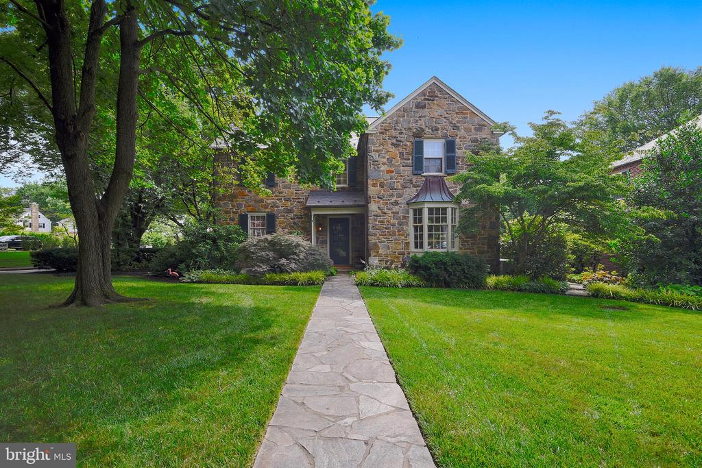 """This classic stone property has been thoughtfully renovated & improved over the years w/ 4 BRMS, 4-1/2 baths & over 3150 sq ft of beautifully maintained living space. An architecturally designed kitchen w/ Breakfast nook & Mud room additions; custom Wood-Mode cabinets; granite ctops & backsplash, 2 Fisher & Paykel dishwasher drawers; Dacor 6 burner gas range w/ oven & steel vent hood; center island w/ granite ctop; 42"""" GE Monogram refrigerator; refreshment dry bar w/ GE beverage refrigerator & porcelain tile flooring. A 21' 1st flr family rm w/ custom storage, surround sound speakers, a gas FP & French doors leading to the bluestone terrace. A totally reconfigured Master BRM suite w/ a tray ceiling, a separate dressing area w/ multiple closets & a mas bath w/ a frameless shower. Enjoy outdoor entertaining on the private,  covered flagstone porch or the bluestone terrace w/ fountain encircled by mature shrubbery & flower beds. Old World details throughout-Seperate office on the 2nd lvl-Generous proportions for entertaining-Major Improvements: slate roof on main house & garage; new gas boiler; 3 additions including mud rm & breakfast nook off kitchen, bay window in DRM; 1st flr fam rm extension + a detached 2 car garage."""