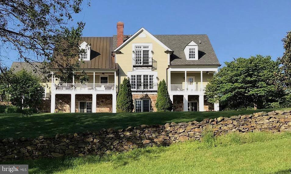 Stunning property offers unique opportunity to own 7.5 Acres within 2 blocks of Main Street Middleburg, VA.  Williamsburg colonial with 3 finished levels, multiple covered porches and gorgeous private views from the back. Extensive stone walls, perennial gardens, heated pool, stocked pond, 2 stall stable, 6+ car garage parking.  Previously within the historic boundary, this property now shares a boundary line with the Town of Middleburg. Owner/Agent