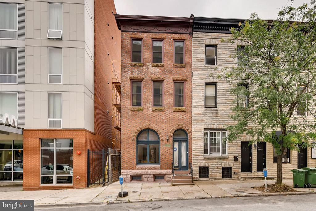 Gorgeous end-of-group Mount Vernon rowhome. Before you even step inside you'll marvel at the stunning brick front and air of classic Baltimore charm - they don't make them like this anymore. Inside you'll find 4 spacious stories with several beautiful built-ins, decorative fireplaces, elegant French doors, a HUGE closet on the second floor, and more. This character-filled home is brimming with endless possibilities!