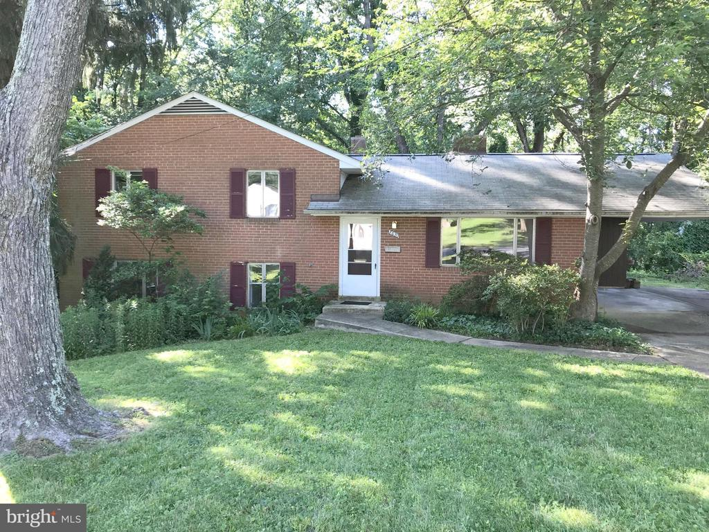 """Great Opportunity! Fixer upper in North Springfield. Half Acre plus lot that backs to woods. Home has large main level family room addition and is totally livable but does need updating. New hot water heater, and roof repairs have been made. Sold """"AS-IS"""""""