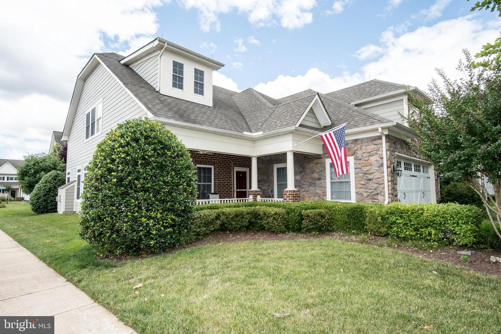 Centex Brunswick Model Home with Front Porch and Rear Patio, Three bedrooms with Three Baths, Gourmet Kitchen with Island, Granite Counters with Stainless Steel Appliances, Family Room off Kitchen, separate Dinning Room, Patio off Kitchen, Second Floor Loft with Bedroom and Bath