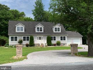 Would you like some peace, quiet  & great  extra  space for your growing family?  This is it!  Super location...  Showell/Bishopville area  and only  3 minutes off of Rt 113 and  only 10 minutes from Ocean City, Berlin & Beach areas! Short drive to schools too!  Abundant space inside & out!  Incredibly spacious Kitchen with  beautiful Cherry Cabinetry, Stainless upgraded Appliances, Cast iron sink & plenty of pantry space! Enjoy the spacious Living area w/wood stove  for added warmth! A perfect place for your growing family with 5 Bedrooms plus an inlaw/suite/office in private setting  off of a 30 x 30 insulated  Garage w/ keyless entry.  Efficient spray foam insulation for maintaining low energy bills  &  in addition to a fully encapsulated crawl space/dehumdifier too! Propane Gas heat on lower level/Heat Pump upstairs with a Wood Stove  for the winter months! Separate Huge Laundry Room.  New front door in 2019. Tons of storage  too!     Transfer Switch installed for possible Generator use.  This is all of the space & privacy you will need... call for your viewing today! 1 Year Home Warranty w/acceptable offer. Playground equipment conveys.  Don't miss this great buy in the Northern end of Worcester County!