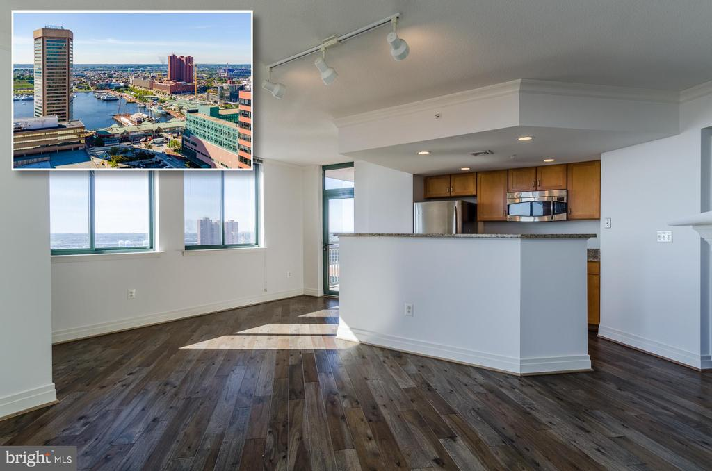 ENJOY UNBELIEVABLE VIEWS OF THE HARBOR FROM THIS 27TH FLOOR UNIT IN THE HEART OF BALTIMORE! Living room w/ hardwood floors & gas fireplace, designer kit w/ granite counters & ss appliances, Master suite w/ walk-in closet & full bath, 2nd bed w/ hall bath, private balcony w/ amazing views & 1 car parking! Building amenities include front desk, outdoor pool, gym, business center, & rec room! Gas/water/sewer incl