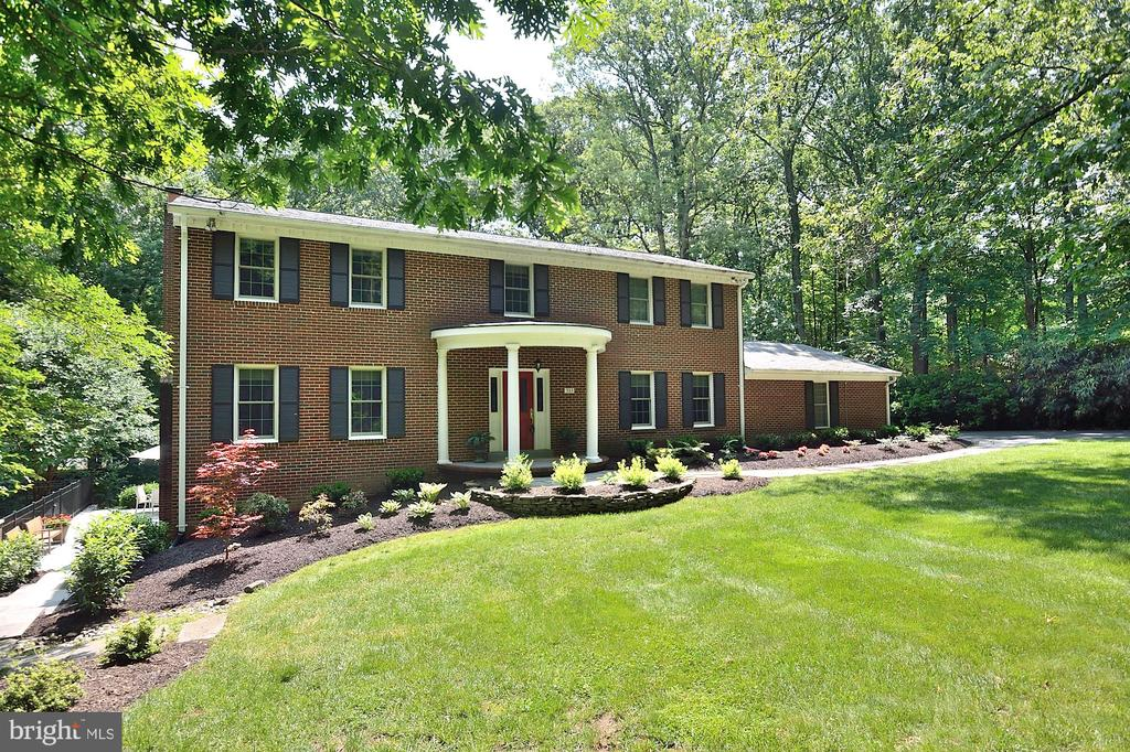 Enjoy your own private resort on 5 acres in the Tally Ho neighborhood of Great Falls.  Exceptional interior and exterior Features in this Brick Center Hall Colonial.  This stunning home is your private retreat tucked away and completely surrounded by breathtaking nature and still close to the amenities in DC, Tysons, and Reston. Settle into this this three story, 3000 sq ft all brick, fully renovated four bedroom home.  The upper level offers large bedrooms with an abundance of closet space.  The main level has a cozy family room that is located off the kitchen and provided easy access to the screened-in porch and deck.  The lower level is the perfect entertaining/relaxing area with French doors to the patio and pool.   All major systems have been replaced/upgraded. (A complete list is provided in the brochure).   The exterior living includes a beautiful heated pool, hot tub, screened porch and state of the art sports/tennis court.   The HOA welcomes owners with horses to use the riding rink and enjoy the scenic pond.