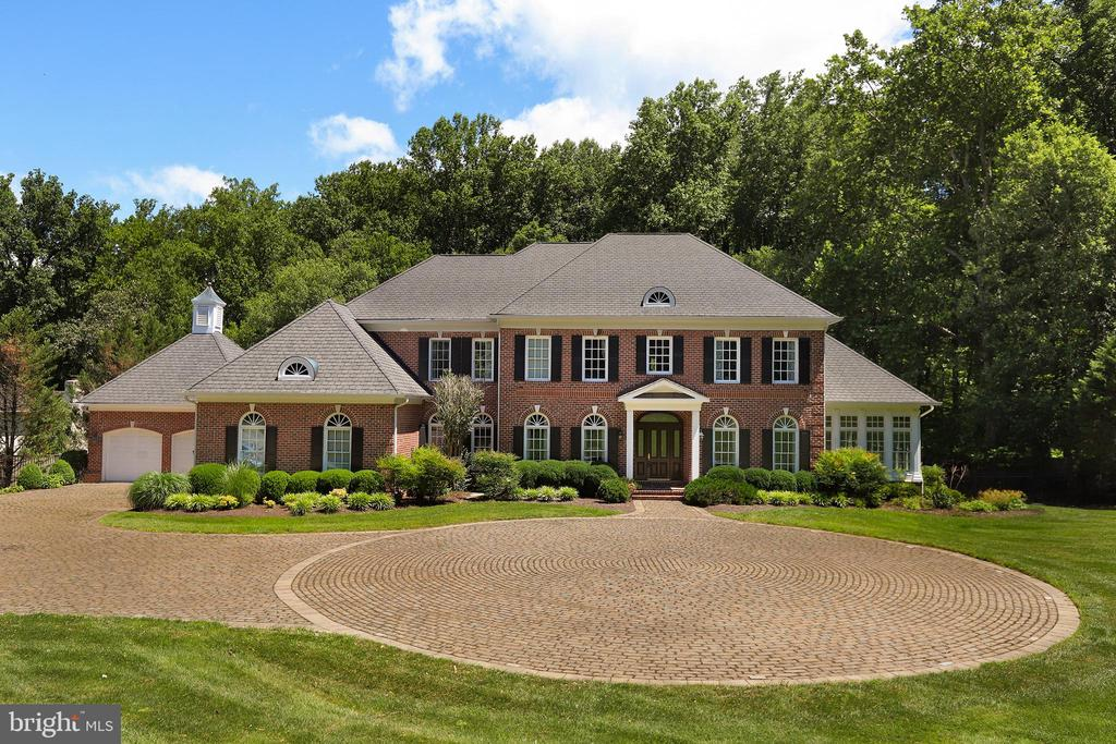 This luxuriously updated estate is located on a beautiful 2.4 acre secluded lot and is situated on the edge of Great Falls and McLean - Just 5 minutes to Tyson's Corner and 20 minutes to DC. This lavish home features a gourmet kitchen, designed by a chef, with dual oven Viking stove and high end SS appliances. An additional oven, dishwasher, and sink located on the island to accommodate any and every cooking need. Built-in entertainment system, and surround sound speakers in every room and around the exterior patio, gazebo, and over-sized pool makes this a perfect home for entertaining. Heated floors and 4 fireplaces gives a cozy feeling as you tour this 7 bedroom, 8 bathroom home with over $1.2 million in upgrades, since in 2012.