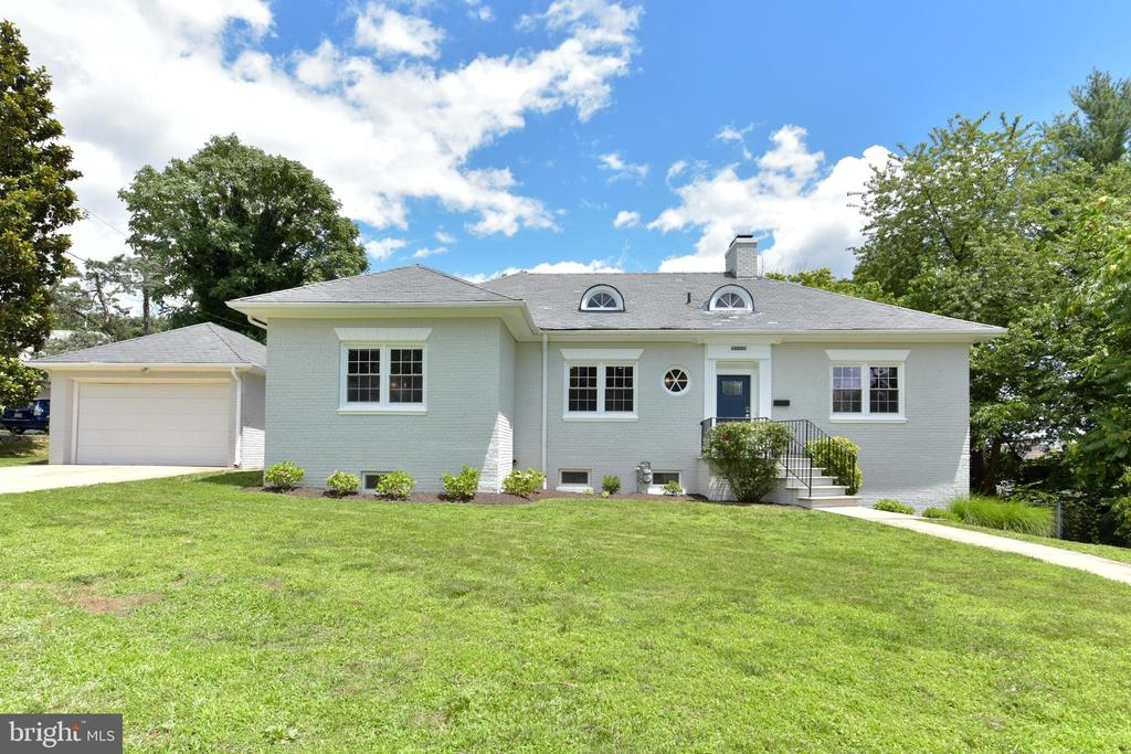 Welcome to this beautifully renovated rambler on a 3/4 acre lot in the City of Alexandria. With a total of 4,100 square feet of finished living space, this home lives large! The main level features a spacious living room with wood burning fireplace, completely renovated kitchen, dining room/study and a half bathroom. The bedroom wing on the main level includes a master suite with a fully renovated bathroom, two additional bedrooms and a fully renovated hall bathroom. Downstairs you will find a bright sunroom that walks out to the large patio, family room with a fireplace and a half bathroom, fourth bedrooms, an office, and a large laundry room. Enjoy dining al fresco on the upper level balcony overlooking the private, level lot and large lower level patio. The two-car garage connects to the home through an enclosed breezeway, perfect for a mud room. Located close to Old Town, shopping, dining, and major commuting routes, this home won't last!