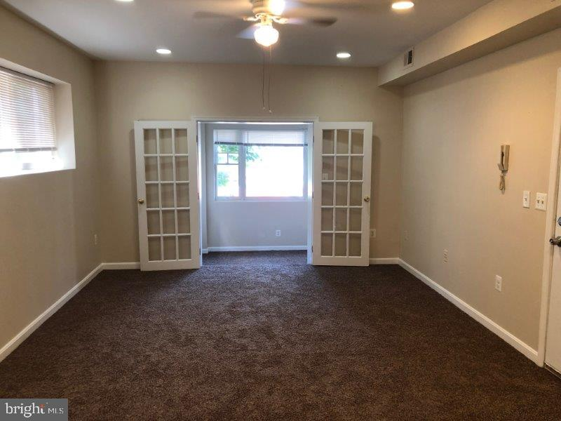 Beautifully Renovated 2 Bedroom 1.5 Bathrooms Apt W/W Carpet Central A/C, Washer,Dryer, Stove, Refrig, Disposal. Sun Room, Freshly painted, near shopping area and public transportation. This is unit is located on the first floor of the building. Parking out pack of the building. Trash services provided. Water included in the rent. Must See!! Will not last long