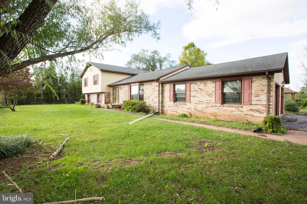 """Approved Short Sale. Photos are prior to tenants trashing house. May be mold, take precautions. Property is on Cedar Run water frontage. House has incredible potential. 2 Wells, unground pool, 10 Acres, 7 Acre Community Lake. Call agent prior to writing. Sold in Strictly """"AS IS"""" Condition"""