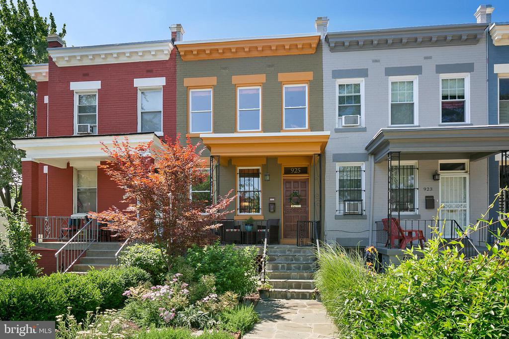 A quintessential row home in the heart of NoMa & the H ST Corridor. Extensively renovated over the past 7 years while preserving all the character, charm, and feels. Walk up to the professionally landscaped garden, custom stone pavers, to the lovely front porch. Inside you will see the restored original hardwood floors, a stunning living room with period details, large open dining room ready for the dinner party, and an expansive kitchen with a natural wood island. An additional den leads to a wonderful deck set for the summer BBQ, private yard, and ample storage areas below. Step back inside to the exposed brick taking one downstairs to the media room with Porcelanosa tile floors, beautiful built-ins with hand crafted counters by a local wood worker, space to stretch out, and a spa-like bathroom. Upstairs you will find three bedrooms. The owner's suite is complete with a south facing sitting room / office and expanded closet space. Another tastefully renovated bathroom and two additional gracious bedrooms are flooded with natural light. Just blocks to Union Market, Whole Foods, Trader Joes, Union Station, H ST NE, and NoMa redline Metro, this stunning home is situated on the ideal block in a premier location.