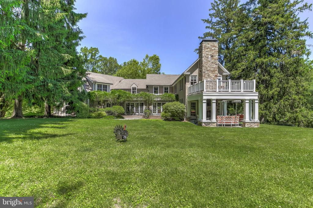 Fabulous location! A hidden gem in secluded private setting on 3.16 acres w/closest proximity to I-83, 695, Falls Rd & Greenspring Ave.  Cedar shake c.1876 Victorian farmhouse thoroughly renovated & seamlessly expanded into a luxury home in 2004 & 2015. The finest materials & craftsmanship. 5 en-suite Bedrooms, 6/1 Baths, 7 fireplaces including covered porch. 2-story Foyer flows to beautiful Gallery hall, large formal Living Room & Dining Room. Stunning gourmet Kitchen w/fireplace flows to Family Room w/FP & beamed ceiling. Large Mudroom w/separate Cloak Room. 1st floor Bedroom suite. Sumptuous & expansive Master Suite w/FP, marble Bath & Dressing Room. 3 additional large Bedrooms, 1 w/FP & private Deck. Lower Level Rec Room w/FP, Billiard Room & full Bath. Incredible outdoor living spaces include Covered Porch w/FP, pergola Deck, Patio & saltwater Pool. All on 3.16 glorious landscaped acres.