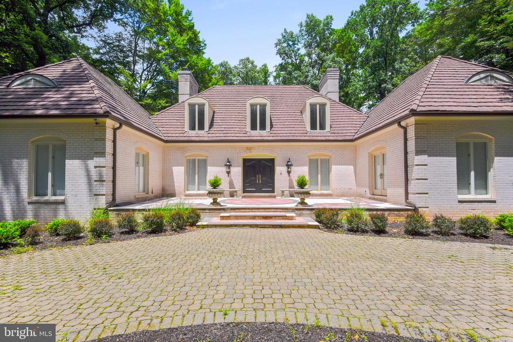 NEWLYREDUCED!Well below market! Magnificent 6 bedroom home on desirable wooded corner lot, located in one of Baltimore's most unique and coveted neighborhoods! Gorgeously remodeled in 2016, with an enormous open Gourmet kitchen, enabling you to dine inside or out with beautiful views of the beautiful, quiet back yard. Bright, wide open access to sprawling family room. 2 car attached side entrance garage with plenty of parking for more. Basement features rec room, exercise room, workshop area, utilities, and ample storage spaces w cabinets.