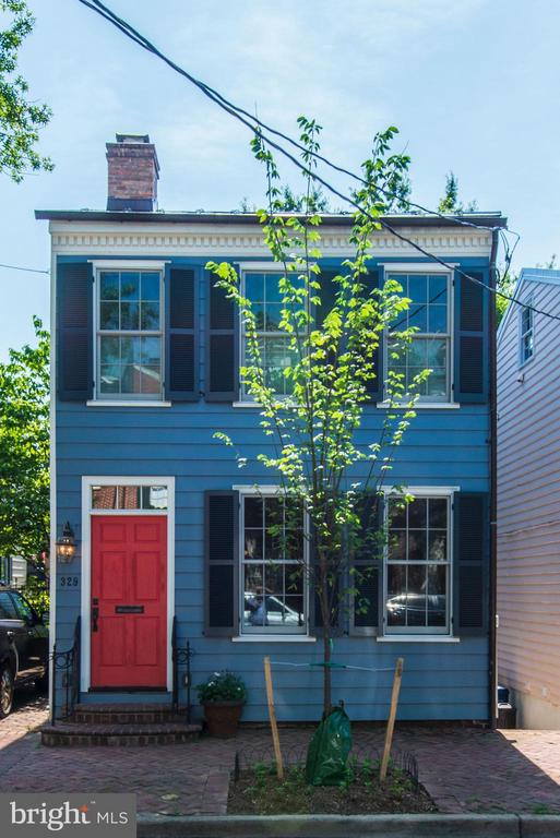 Totally reimagined and renovated into a contemporary gem, 329 North Asaph Street retains its historic exterior, blending with the charm of the neighborhood while making its own striking modern statement inside! Current owners have respected the integrity yet tailored the interior to today~s tastes for those seeking generous natural light with windows on all 4 sides, and an open-concept layout for easy living and entertaining.This totally detached, tastefully redone home with 2 bedrooms and 3 full baths is beautified by reclaimed hardwood floors, all new Pella windows, stone accents, refined finishes, and other unique features throughout. Several original elements were repurposed, such as the bricks from the original fireplace now incorporated in the lower staircase wall, along with bricks from the original foundation. Original floor boards (all whitewashed) line the stairwell walls on all 3 floors. A wood-burning fireplace in the living room and wood/glass cabinetry dividing the dining room area from the gourmet kitchen space add chic modern touches.The stylish chef~s kitchen is appointed with wood cabinets, soapstone countertops, and all Viking stainless steel appliances.The open metal staircase is artistic featuring lights illuminating each step ~ the same lighting found in the second floor hall wall of bookshelves and art niche. At the top of the staircase, a sliding barn door reveals a comfortable guest room. The master bedroom, with exposed brick of the fireplace chimney of the living room below, boasts a vaulted ceiling and an inviting ambiance. All bathrooms are sleek and professionally designed. The master bath has a seamless glass shower and rectangular white sink with open storage for towels below,and the guest bath is adorned with a rich natural wood vanity and freestanding tub.On the lower level sits a family room with glass doors leading out to the patio and garden,as well as a bonus room with windows and a closet that can serve as a home office or thir